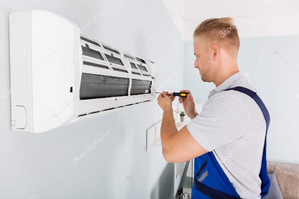 a technician installing a split type AC
