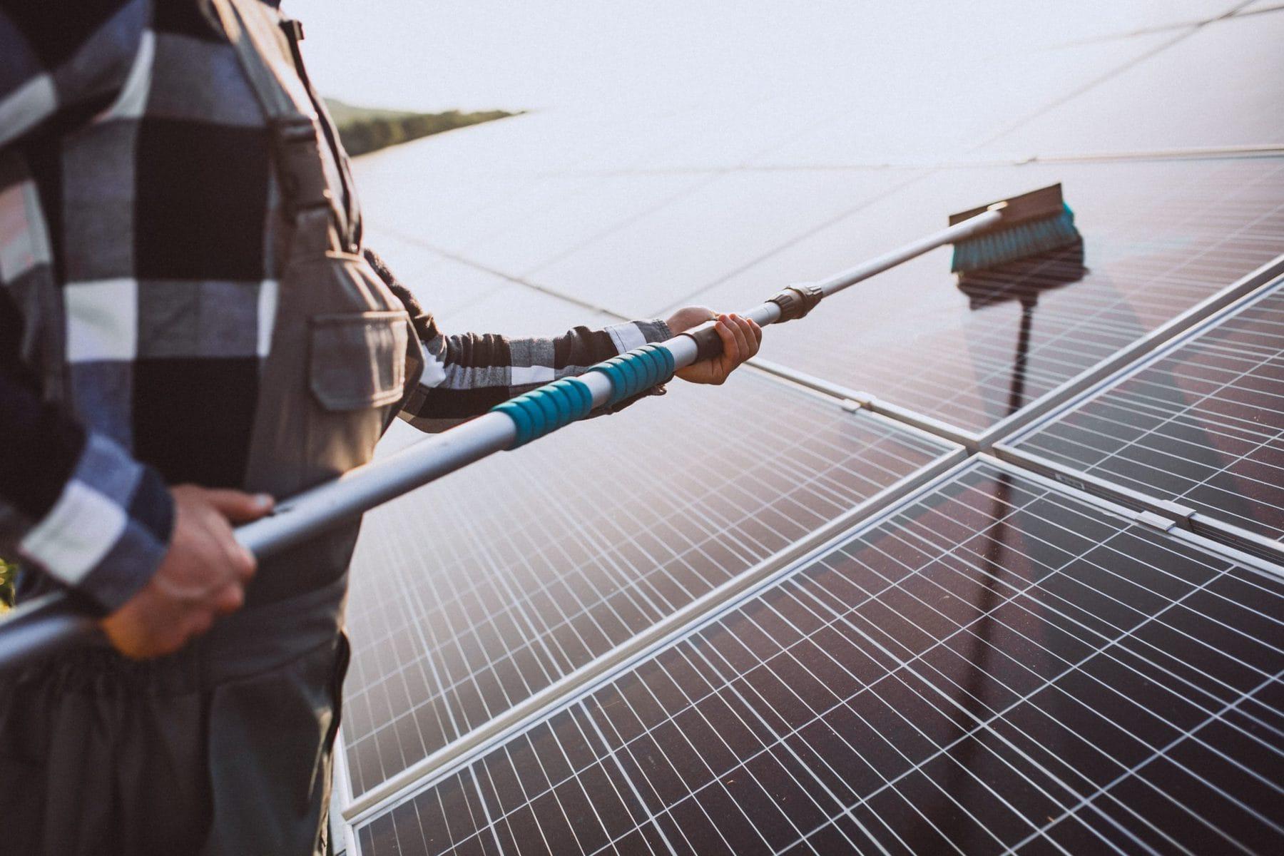 man worker firld by solar panels